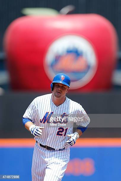 Lucas Duda of the New York Mets rounds third base after hitting a solo home run in the first inning against the Philadelphia Phillies at Citi Field...