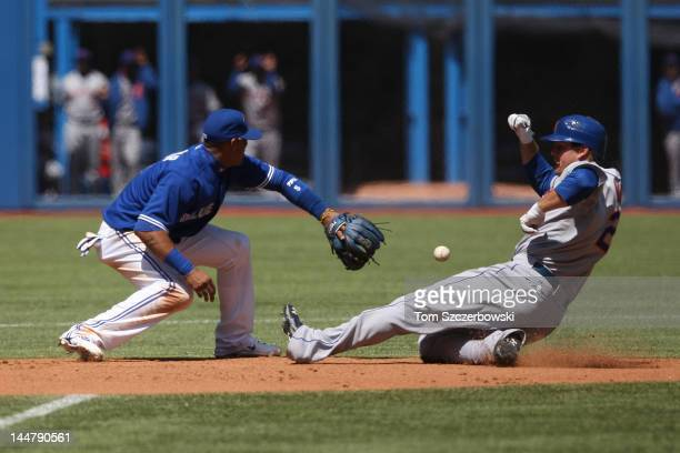 Lucas Duda of the New York Mets slides into second base with a double in the 5th inning during MLB game action as Yunel Escobar of the Toronto Blue...