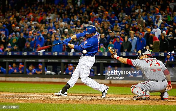 Lucas Duda of the New York Mets strikes out swinging in the ninth inning against Max Scherzer of the Washington Nationals at Citi Field on October 3...