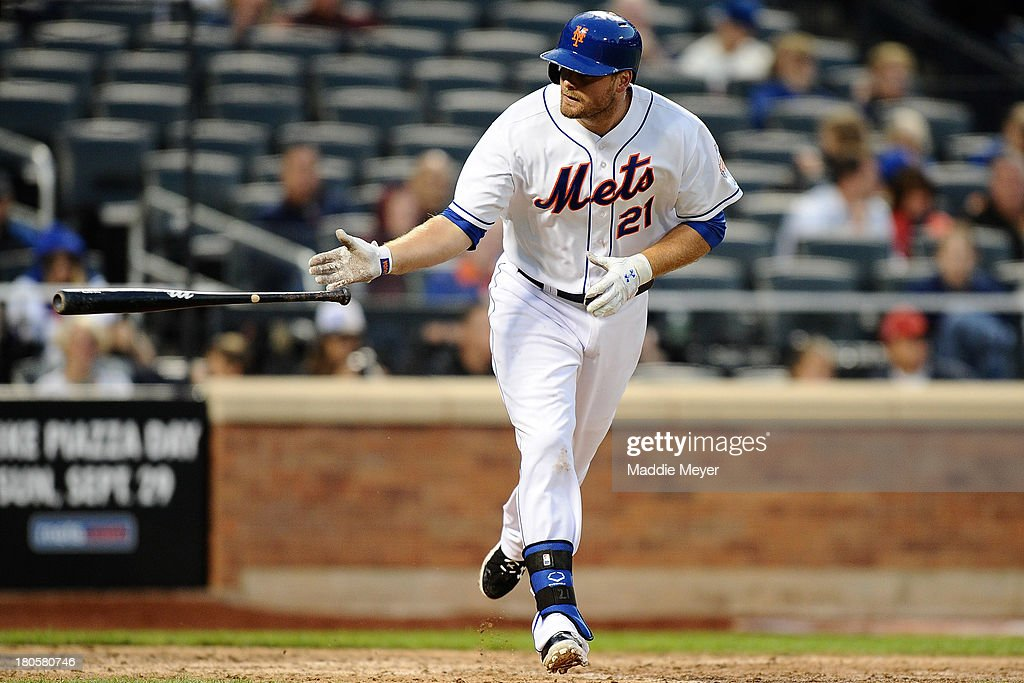 Lucas Duda #21 of the New York Mets tosses his bat as he walks to first base during the ninth inning against the Miami Marlins at Citi Field on September 14, 2013 in the Flushing neighborhood of the Queens borough of New York City. The Marlins defeated the Mets 3-0.