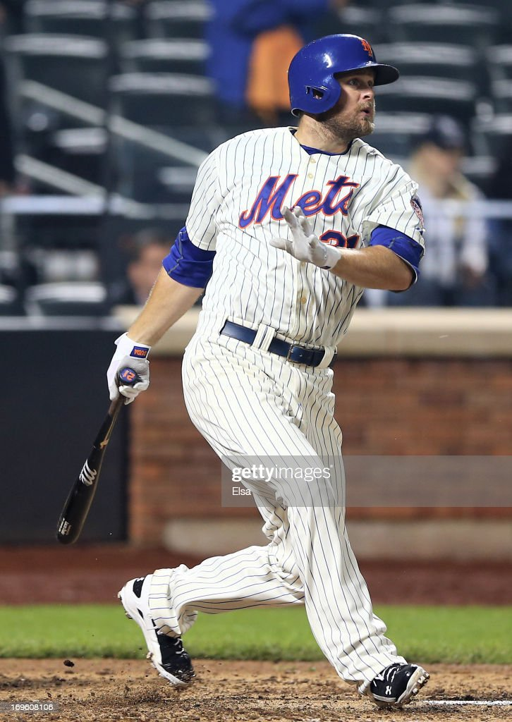 Lucas Duda of the New York Mets watches his game winning RBI in the ninth inning against the New York Yankees on May 28 2013 at Citi Field in the...