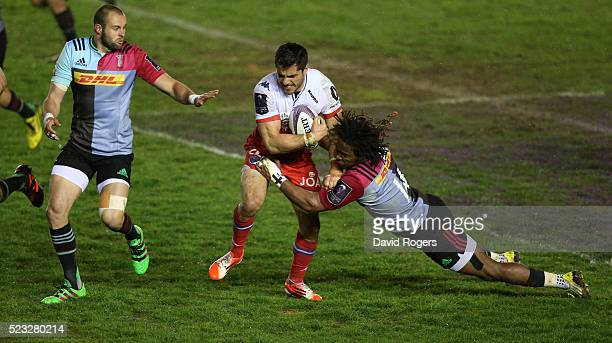 Lucas Dupont of Grenoble is tackled by Marland Yarde during the European Rugby Challenge Cup semi final match between Harlequins and Grenoble at...