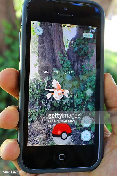Lucas Garcia takes aim at a Pokémon Go monster on his smartphone in a park in Alameda California on July 11 2016 Pokémon Go mania is sweeping the US...
