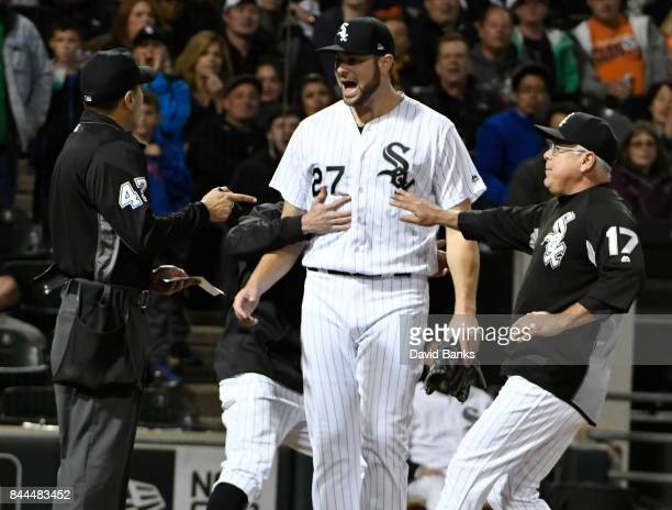 Lucas Giolito of the Chicago White Sox is restrained by Rick Renteria of the Chicago White Sox as he argues with home plate umpire Gabe Morales...