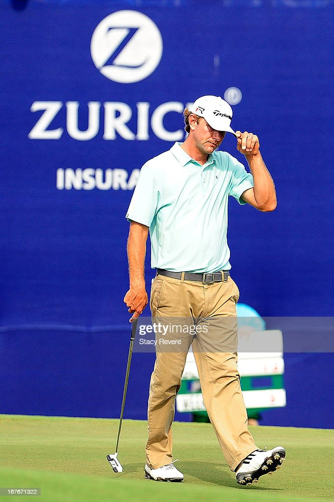 Lucas Glover acknowledges the crowd on the 18th hole following the third round of the Zurich Classic of New Orleans at TPC Louisiana on April 27, 2013 in Avondale, Louisiana.