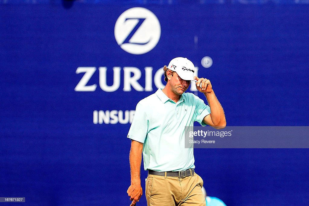 Lucas Glover acknowledges the crowd on the 18th hole following the third round of the Zurich Classic of New Orleans at TPC Louisiana on April 27 2013...