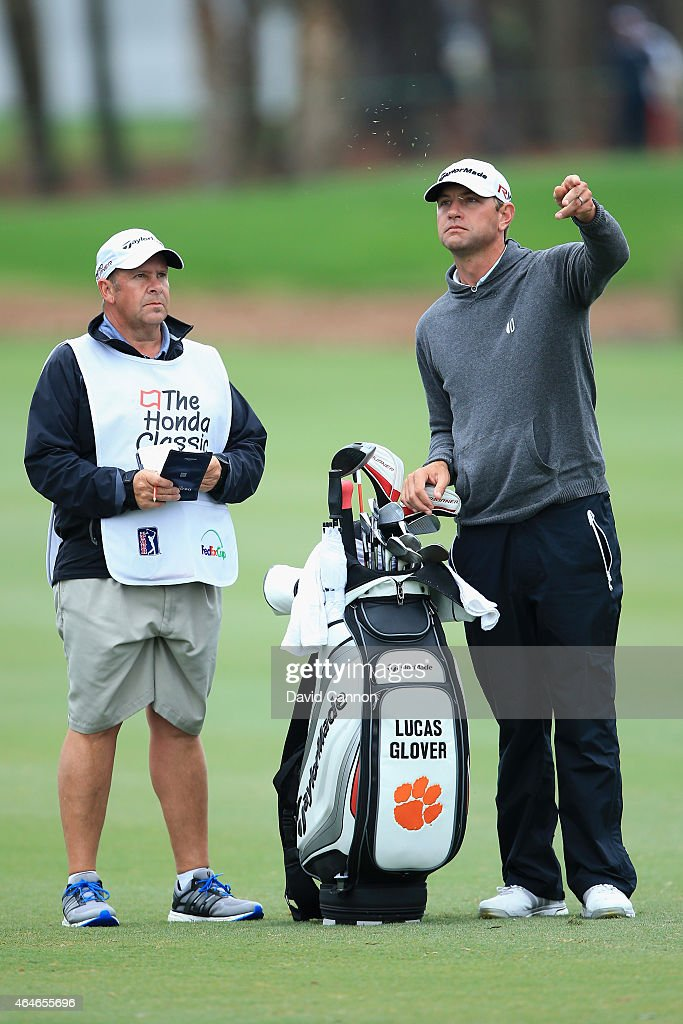 Lucas Glover and his caddie are seen on the ninth hole during the second round of The Honda Classic at PGA National Resort Spa Champion Course on...