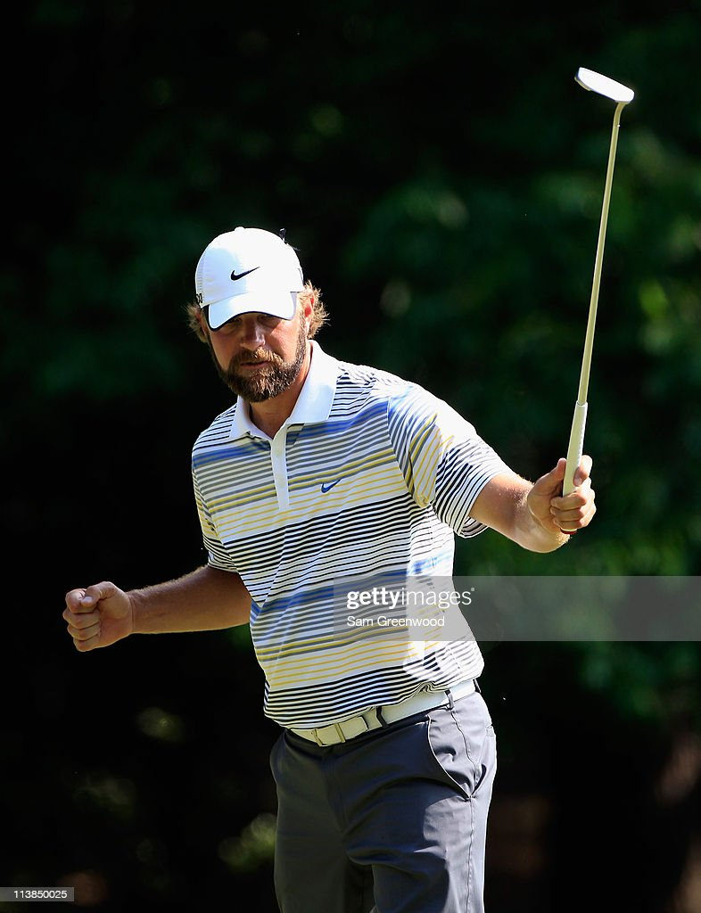 Lucas Glover celebrates a birdie putt on the 13th green during the final round of the Wells Fargo Championship at the Quail Hollow Club on May 8 2011...