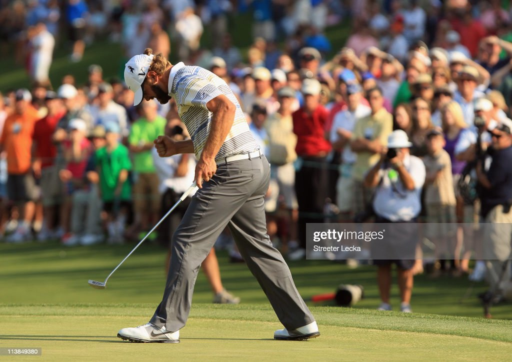 Lucas Glover celebrates his par saving putt on the 18th green during the final round of the Wells Fargo Championship at the Quail Hollow Club on May...