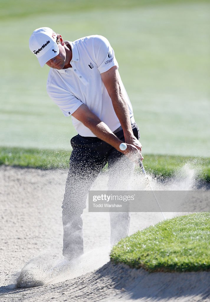 Lucas Glover chips in for eagle from the bunker on the 18th hole during the third round of the Farmers Insurance Open at Torrey Pines South on...