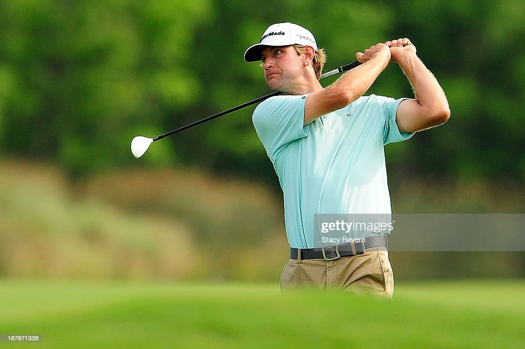 Lucas Glover hits his second shot on the 18th hole during the third round of the Zurich Classic of New Orleans at TPC Louisiana on April 27, 2013 in Avondale, Louisiana.