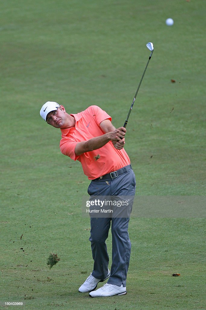Lucas Glover hits his second shot on the ninth hole during the first round of the Wyndham Championship at Sedgefield Country Club on August 16 2012...