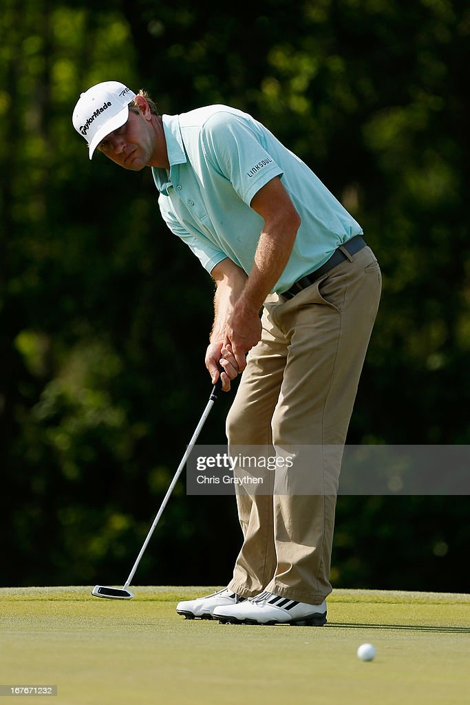 Lucas Glover makes a putt on the 15th hole during the third round of the Zurich Classic of New Orleans at TPC Louisiana on April 27, 2013 in Avondale, Louisiana.