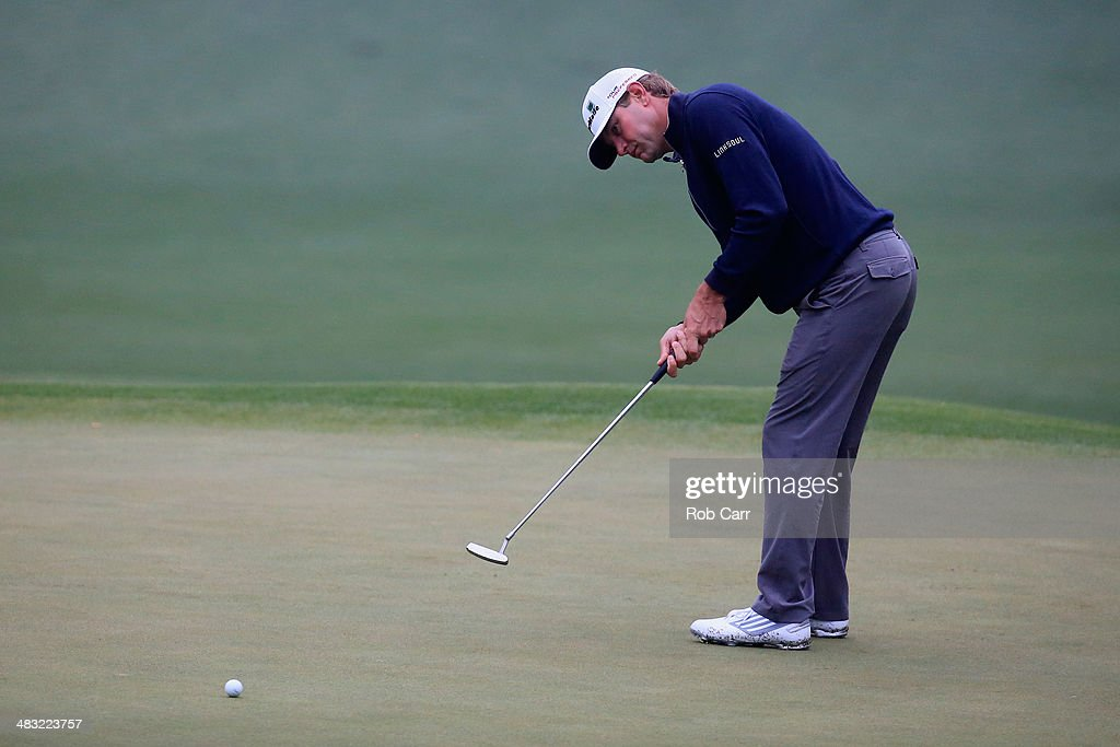 Lucas Glover of the United States putts during a practice round prior to the start of the 2014 Masters Tournament at Augusta National Golf Club on...