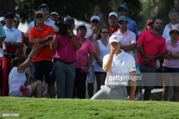 Lucas Glover of the United States reacts to his shot to the 14th green during the final round of THE PLAYERS Championship at the Stadium course at...
