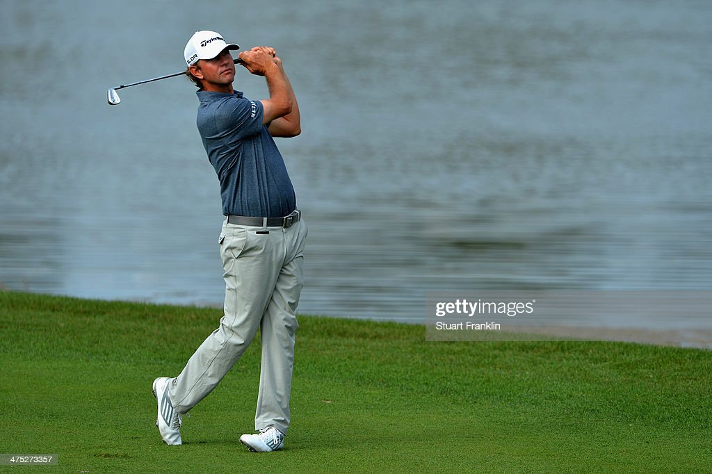 Lucas Glover plays a shot on the 6th hole during the first round of The Honda Classic at PGA National Resort and Spa on February 27 2014 in Palm...