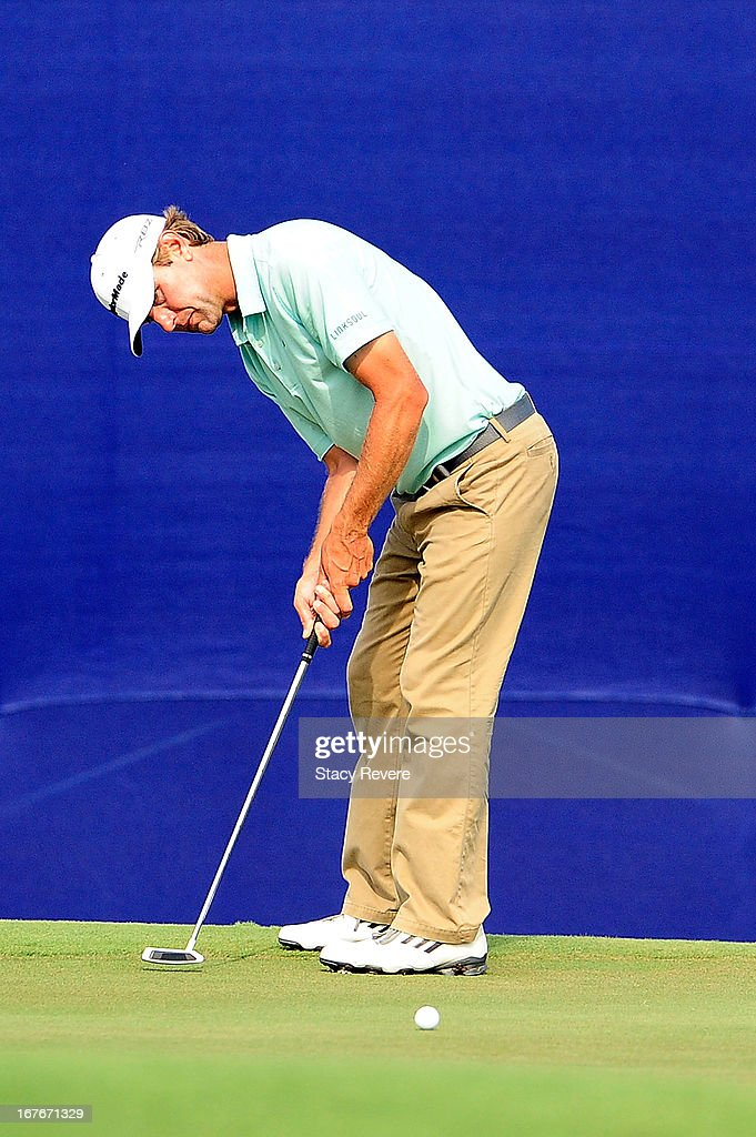 Lucas Glover putts on the 18th green during the third round of the Zurich Classic of New Orleans at TPC Louisiana on April 27, 2013 in Avondale, Louisiana.