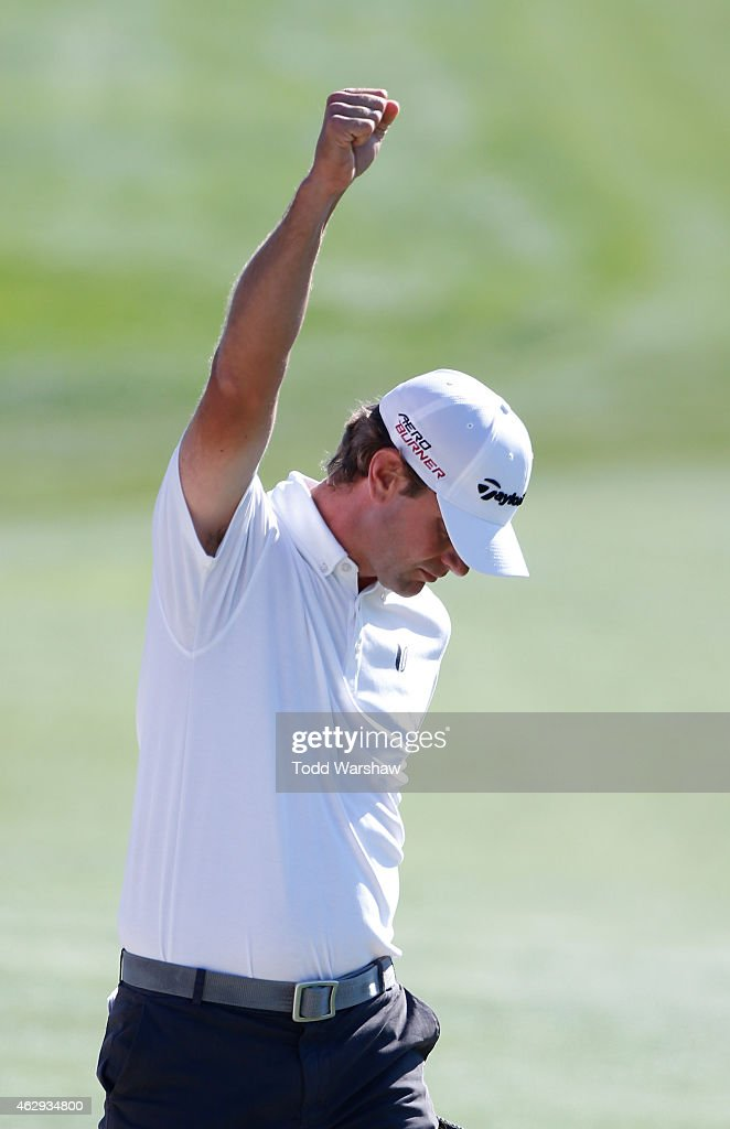 Lucas Glover reacts after chipping in for eagle from the bunker on the 18th hole during the third round of the Farmers Insurance Open at Torrey Pines...