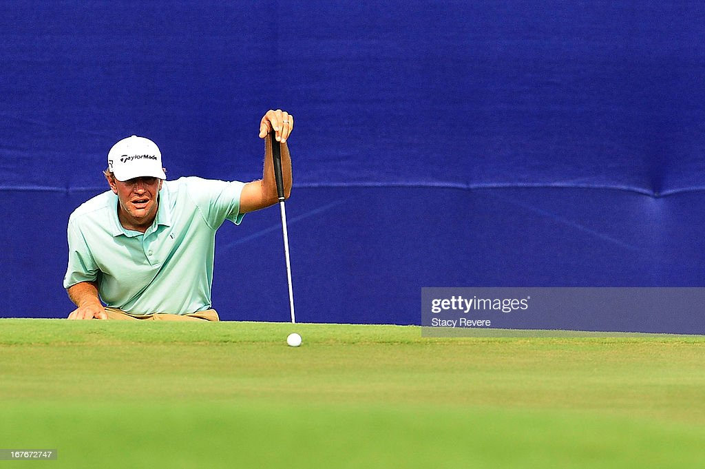 Lucas Glover reads a putt on the 18th green during the third round of the Zurich Classic of New Orleans at TPC Louisiana on April 27, 2013 in Avondale, Louisiana.