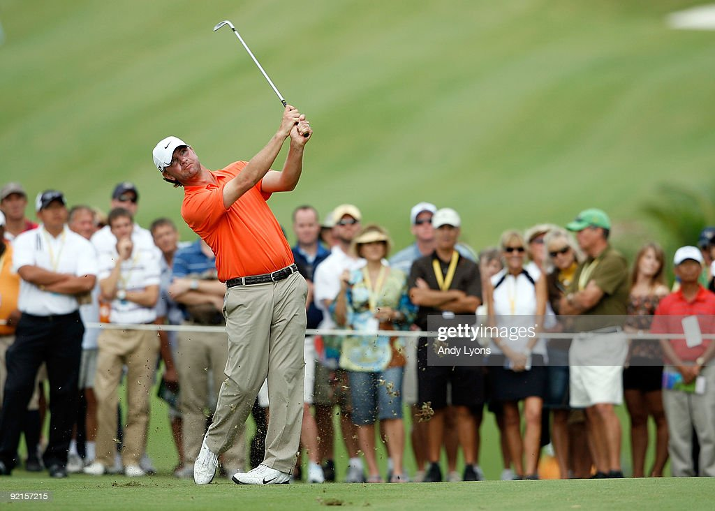Lucas Glover the 2009 US Open champion hits his second shot on the 14th hole during the final round of the PGA Grand Slam of Golf on October 21 2009...