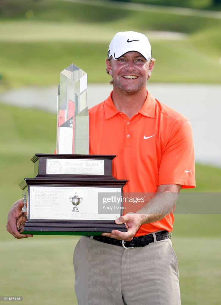 Lucas Glover the 2009 US Open champion poses with the trophy after winning the PGA Grand Slam of Golf on October 21 2009 at Port Royal Golf Course in...
