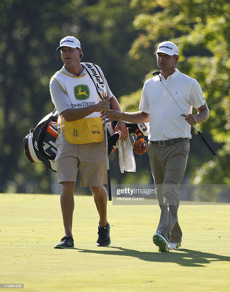 Lucas Glover walks with his caddie during the second round of the John Deere Classic held at TPC Deere Run on July 12 2013 in Silvis Illinois