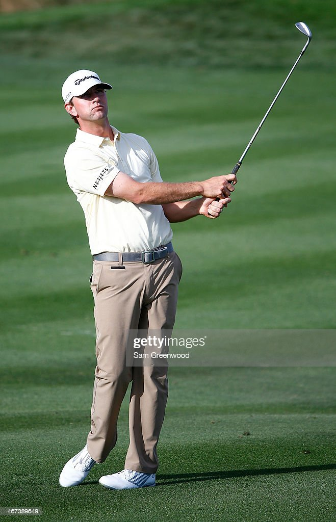 Lucas Glover watches his shot during the first round of the Waste Management Phoenix Open at TPC Scottsdale on January 30 2014 in Scottsdale Arizona