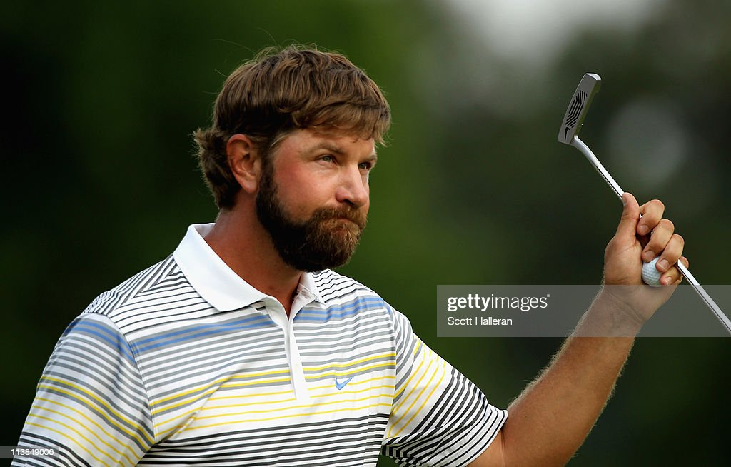 Lucas Glover waves to the gallery on the 18th green after defeating Jonathan Byrd on the first playoff hole during the final round of the Wells Fargo...