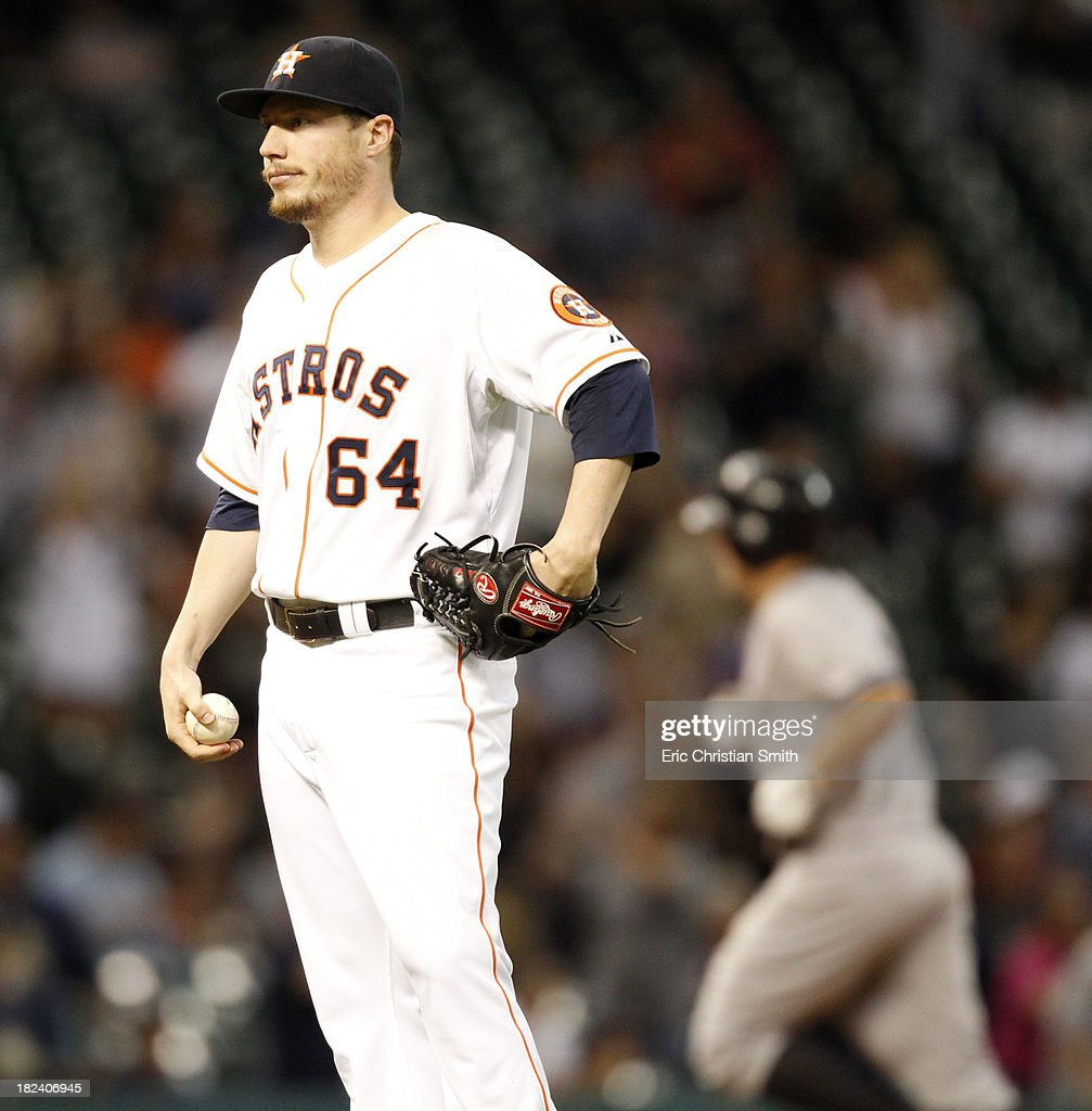 <a gi-track='captionPersonalityLinkClicked' href=/galleries/search?phrase=Lucas+Harrell&family=editorial&specificpeople=4946913 ng-click='$event.stopPropagation()'>Lucas Harrell</a> #64 of the Houston Astros looks away as <a gi-track='captionPersonalityLinkClicked' href=/galleries/search?phrase=Mark+Reynolds+-+Baseball+Player&family=editorial&specificpeople=2343799 ng-click='$event.stopPropagation()'>Mark Reynolds</a> #39, right, of the New York Yankees rounds the bases after hitting a solo home run during the fourteenth inning on September 29, 2013 at Minute Maid Park in Houston, TX.