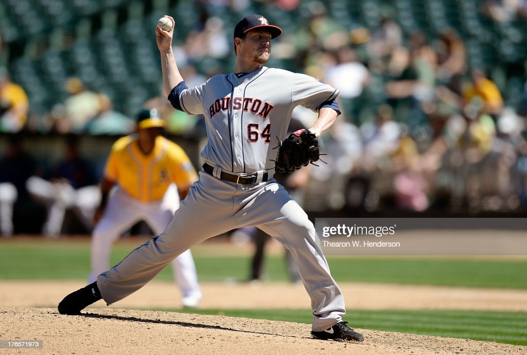 <a gi-track='captionPersonalityLinkClicked' href=/galleries/search?phrase=Lucas+Harrell&family=editorial&specificpeople=4946913 ng-click='$event.stopPropagation()'>Lucas Harrell</a> #64 of the Houston Astros pitches in the fifth inning against the Oakland Athletics at O.co Coliseum on August 15, 2013 in Oakland, California.