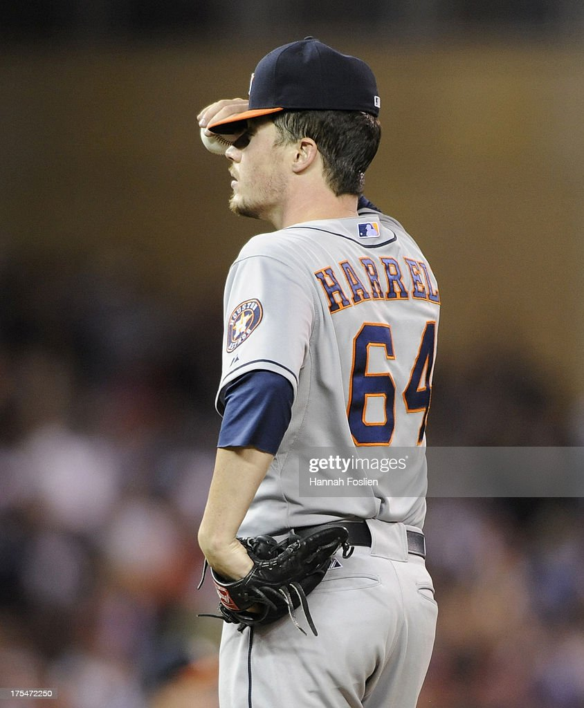 <a gi-track='captionPersonalityLinkClicked' href=/galleries/search?phrase=Lucas+Harrell&family=editorial&specificpeople=4946913 ng-click='$event.stopPropagation()'>Lucas Harrell</a> #64 of the Houston Astros reacts to issuing a bases loaded walk to Oswaldo Arcia #31 of the Minnesota Twins during the seventh inning of the game on August 3, 2013 at Target Field in Minneapolis, Minnesota. The Twins defeated the Astros 6-4.