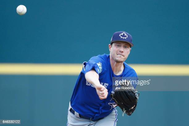 Lucas Harrell of the Toronto Blue Jays warms up before the first inning of a Grapefruit League spring training game against the Pittsburgh Pirates at...