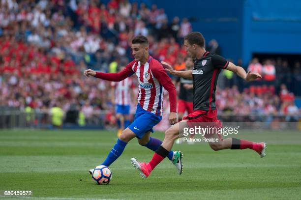 Lucas Herandez of Atletico de Madrid competes for the the ball with Oscar de Marcos of Athletic Club Bilbao of the La Liga match between Club...