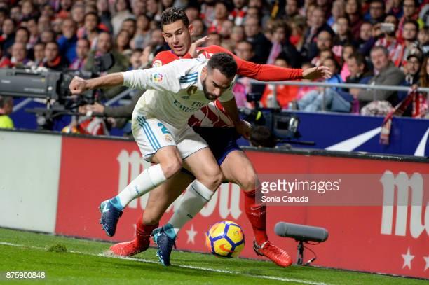 Lucas Hernandez #19 of Atletico de Madrid and Carvajal #2 of Real Madrid during The La Liga match between Club Atletico Madrid v Real Madrid at Wanda...