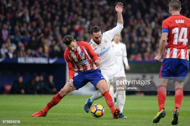 Lucas Hernandez #19 of Atletico de Madrid and Carvajal #2 of Real Madrid during The La Liga match between Club Atletico Madrid v Real Madrid at Wanda...