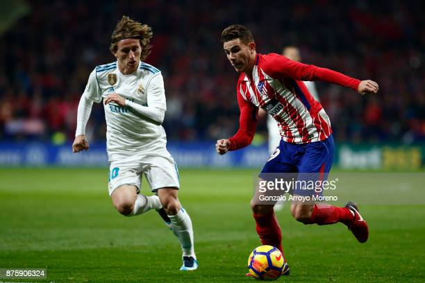Lucas Hernandez of Atletico de Madrid competes for the ball with Luka Modric of Real Madrid CF during the La Liga match between Club Atletico Madrid...
