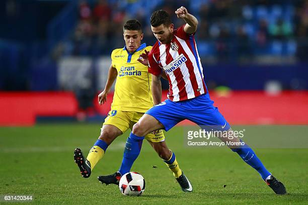 Lucas Hernandez of Atletico de Madrid competes for the ball with Mateo Ezequiel Garcia of UD Las Palmas during the Copa del Rey Round of 16 second...