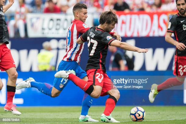 Lucas Hernandez of Atletico de Madrid fights for the ball with Yeray Alvarez Lopez of Athletic Club during the La Liga match between Atletico de...