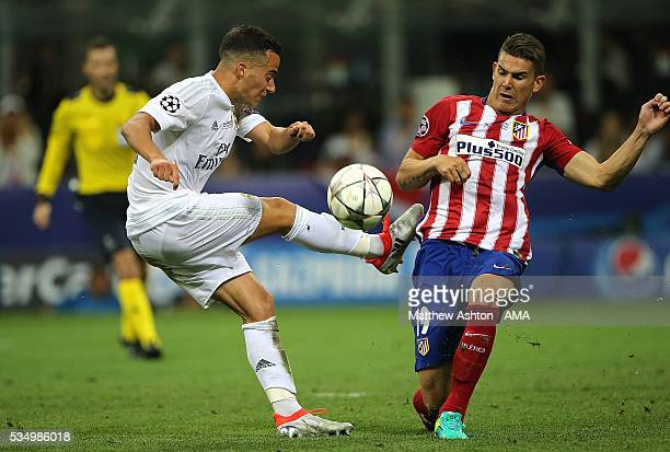 Lucas Hernandez of Atletico Madrid competes with Luca Vazquez of Real Madrid during the UEFA Champions League final match between Real Madrid and...