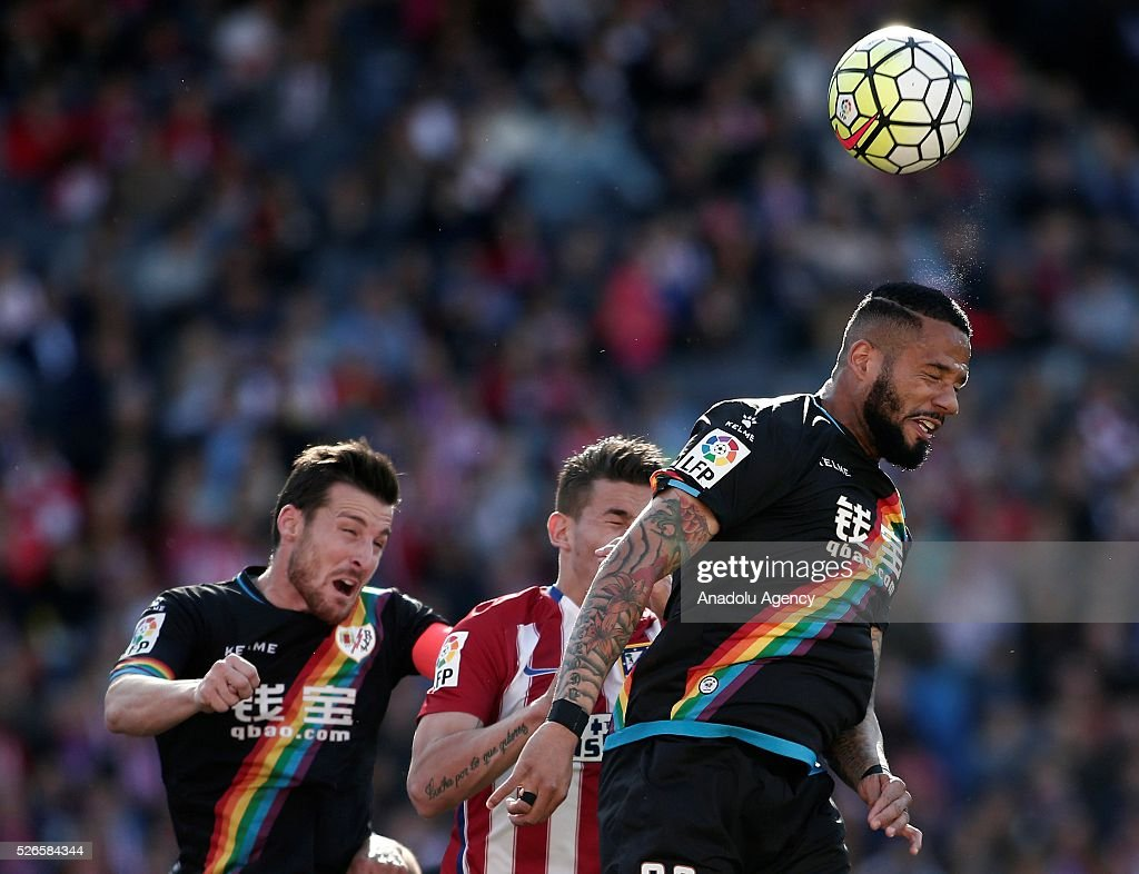 Lucas Hernandez (C) of Atletico Madrid vies with Bebe (R) of Rayo Vallecano during the La Liga football match between Atletico Madrid and Rayo Vallecano at Vicente Calderon, in Madrid, Spain on April 30, 2016.