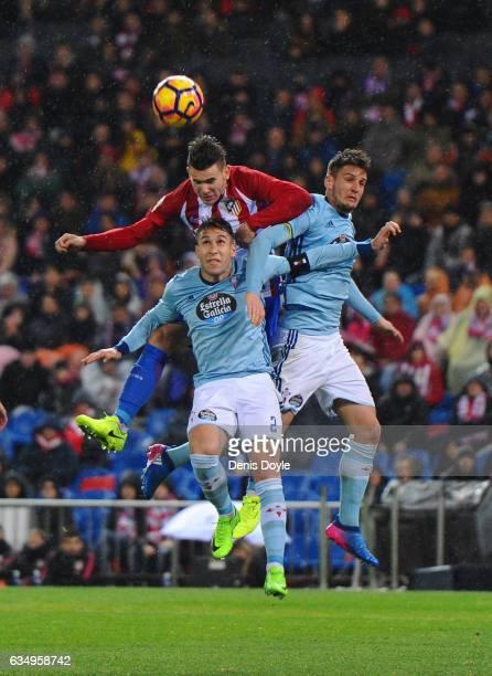 Lucas Hernandez of Club Atletico de Madrid battlet for the ball against Hugo Mallo of Celta de Vigo during the La Liga match between Club Atletico de...