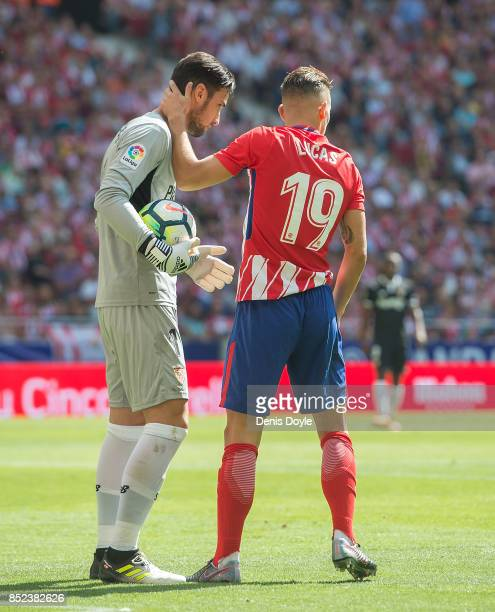 Lucas Hernandez of Club Atletico de Madrid makes amends after sliding into Sergio Rico of Sevilla FC during the La Liga match between Atletico Madrid...