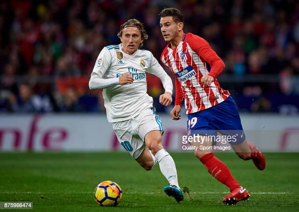 Lucas Hernandez Pi of Atletico Madrid competes for the ball with Luka Modric of Real Madrid during the La Liga match between Atletico Madrid and Real...