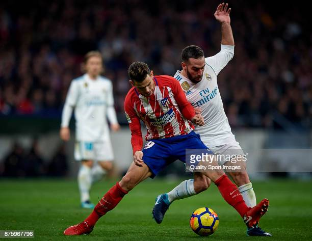 Lucas Hernandez Pi of Atletico Madrid competes for the ball with Daniel Carvajal of Real Madrid during the La Liga match between Atletico Madrid and...