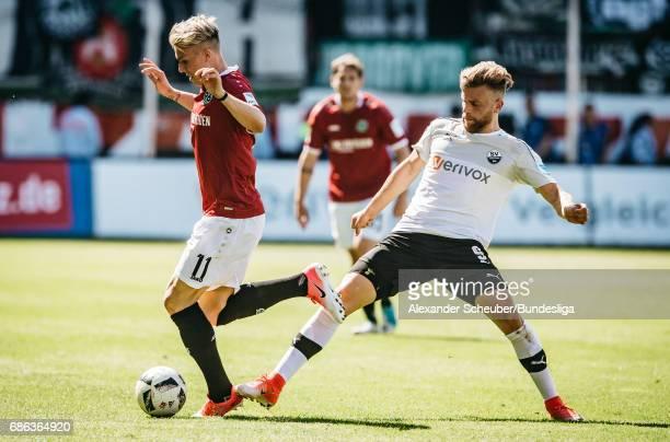 Lucas Hoeler of Sandhausen challenges Felix Klaus of Hannover 96 during the Second Bundesliga match between SV Sandhausen and Hannover 96 at...