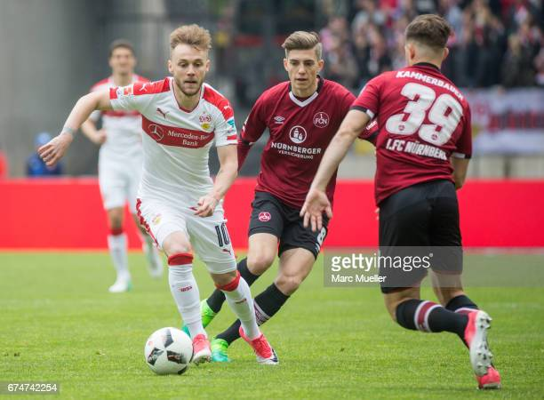Lucas Hufnagel and Patrick Kammerbauer of Nuernberg are challenged by Alexandru Maxim of Stuttgart during the Second Bundesliga match between 1 FC...