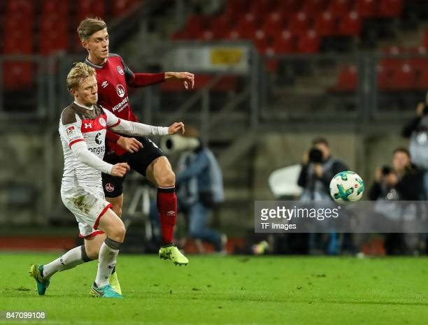 Lucas Hufnagel of Nuernberg und Mats Moeller Daehli of St Pauli battle for the ball during the Second Bundesliga match between 1 FC Nuernberg and FC...