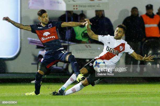 Lucas Janson of Tigre fights for the ball with Gonzalo Martinez of River Plate during a match between Tigre and River Plate as part of Superliga...