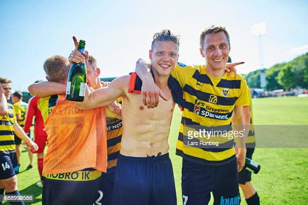 Lucas Jensen and Sebastian Andersen of Hobro IK celebrate winning the match and the NordicBet LIGA with promotion to the Alka Superliga after the...