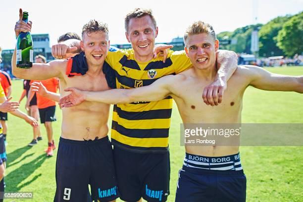 Lucas Jensen Sebastian Andersen and Jesper Boge of Hobro IK celebrate winning the match and the NordicBet LIGA with promotion to the Alka Superliga...